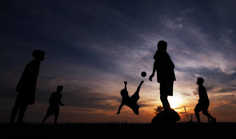 Image result for foto anak-anak bermain sepak bola