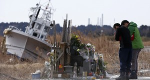 People pray for victims of the March 11, 2011 earthquake and tsunami at Namie town, Fukushima prefecture