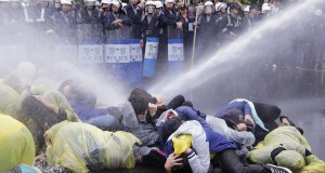 Police use water cannon to disperse demonstrators protesting construction of fourth nuclear plant, in front of Taipei Railway station in Taipei