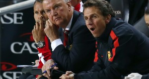 Manchester United manager Louis van Gaal and assistant manager Ryan Giggs watch from the bench during their League Cup soccer match against Milton Keynes Dons at stadiummk in Milton Keynes