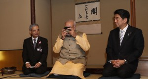 India's Prime Minister Modi enjoys a cup of green tea next to Japan's Prime Minister Abe during a tea ceremony at the Omotesenke tea hut in Tokyo