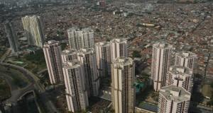 Suasana pertumbuhan pembangunan proyek apartemen di kawasan Kuningan, Jakarta Selatan,