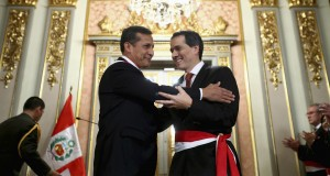 Peru's President Ollanta Humala embraces New Finance Minister Alonso Segura after the swearing-in ceremony at the government palace in Lima