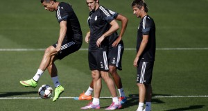 Real Madrid's Ronaldo controls the ball next to teammates Bale and Coentrao during their training session on the eve of their Champions League match against Basel