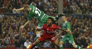 Liverpool's Sterling is challenged by Ludogorets' Moti during their Champions League soccer match at Anfield in Liverpool