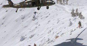 Hiker is lifted by a rescue helicopter of JSDF during a rescue operation at Mt. Ontake, which straddles Nagano and Gifu prefectures, central Japan