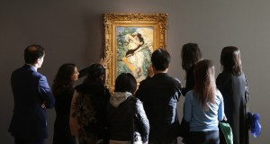 """Visitors look at the painting """"Le Printemps"""" by French painter Edouard Manet during its presentation at Christie's Auction House in Paris"""