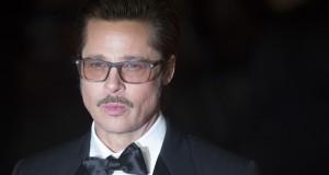 "U.S. actor Brad Pitt poses before a gala screening of his film  ""Fury"" in London"