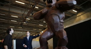 French chocolate maker Jean-Paul Hevin talks with his assistant next to his four-metre tall chocolate King-Kong created by Richard Orlinski in Paris