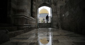 Visitor walks toward the Dome of the Rock in Jerusalem's Old City