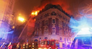 Fire fighters extinguish a fire after a gas explosion at an apartment building in the center of Katowice