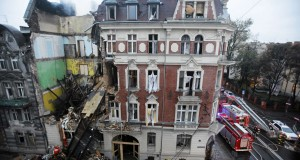 Fire fighters are seen at scene of gas explosion at an apartment building in the center of Katowice
