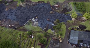 Construction crews try divert lava from Mt. Kilauea from a home in the village of Pahoa, Hawaii