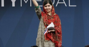 Malala Yousafzai, awarded the 2014 Liberty Medal, acknowledges applause at the conclusion of the ceremony at the National Constitution Center in Philadelphia