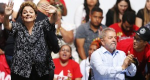 Brazil's President and Workers' Party (PT) presidential candidate Rousseff  waves next to Brazil's former President Luiz Inacio Lula as they attend a campaign rally in Sao Paulo