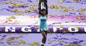 Williams of the U.S. poses with the trophy after defeating Halep of Romania in the women's singles final tennis match of the WTA Finals at the Singapore Indoor Stadium