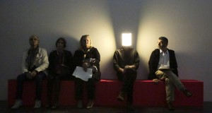 "A man in an LED light mask performs the live art piece ""Player"" as he sits among visitors during the press preview of French artist Pierre Huyghe's first major retrospective at the Los Angeles County Museum of Art in Los Angeles, California"