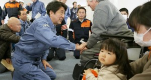 Abe meets with victims of the earthquake which jolted central Japan on Saturday, at a shelter in Hakuba town