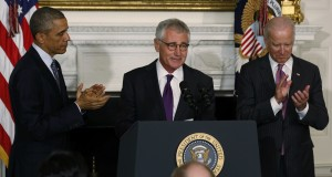 U.S. President Obama and Vice President Biden applaud outgoing Defense Secretary Hagel at the White House in Washington