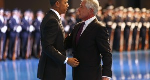U.S. President Barack Obama greets outgoing U.S. Defense Secretary Chuck Hagel during a farewell ceremony at Joint Base Myer-Henderson Hall in Virginia